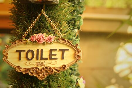 gents: toilet vintage label on a brown background.