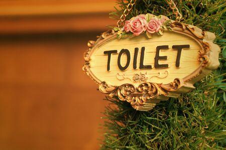 gent's: toilet vintage label on a brown background.