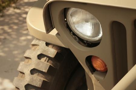 headlights: The headlights of a car on the street