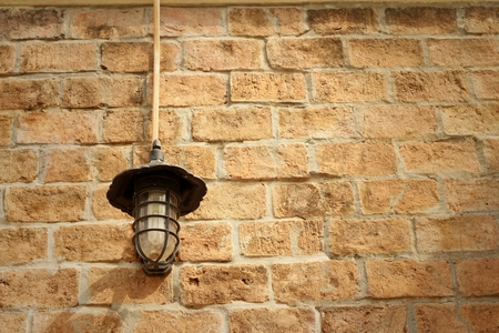 lustre: Wall lamp on a rocks background at the park