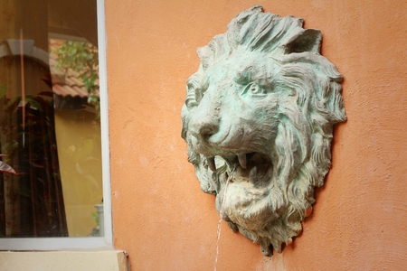 spurt: lion statue spitting water at the park Stock Photo