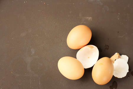 eggshell: eggs and eggshell isolated on brown background