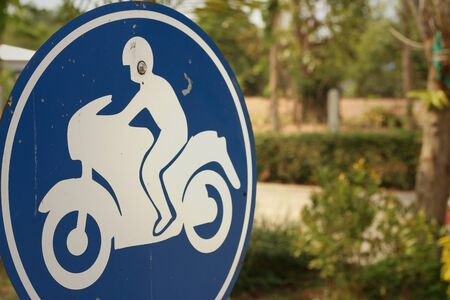 relate: Sign displaying the international symbol for a motorcycle