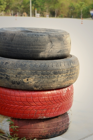 speedway: Tires on the road at the speedway.