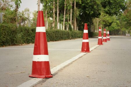 orange traffic cones on the road at the park. Stock Photo