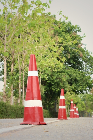 traffic   cones: orange traffic cones on the road at the park. Stock Photo