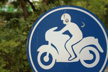 divulge: Sign displaying the international symbol for a motorcycle