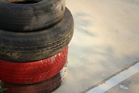 unused: Tires on the road at the speedway.