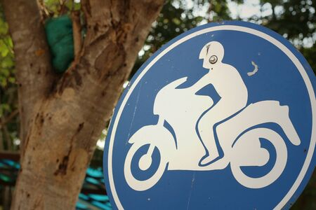 counsel: Sign displaying the international symbol for a motorcycle