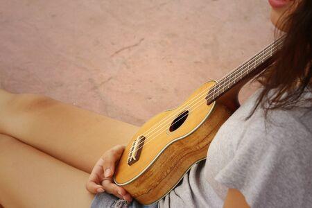 acoustical: Woman playing ukulele, vintage style Stock Photo