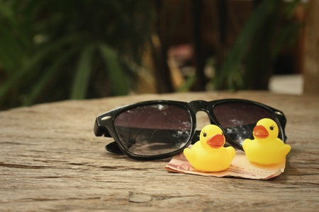 Sunglasses With Yellow Rubber Duck On Green Grass . Stock Photo ...