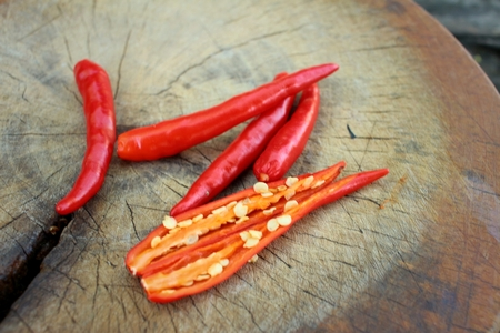 trencher: Red chili on chopping block at kitchen. Stock Photo