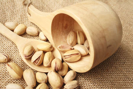 macrobiotic: Pistachios nuts on a background of brown Stock Photo
