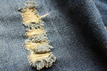 torn jeans: Background or texture of blue torn jeans.