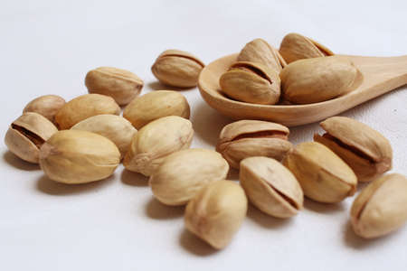 whitem: Pistachios nuts on a background of white