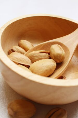 macrobiotic: Pistachios nuts on a background of white
