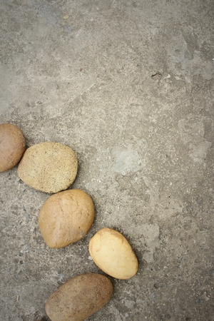 aggregates: Stones background on cement background at the park