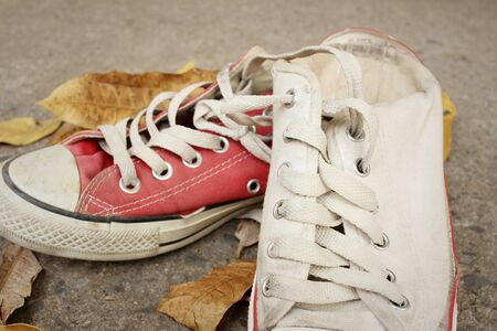 Red and white shoes on background of cement. Stock Photo - 60611485