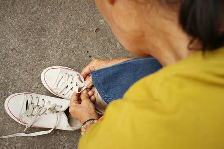 White shoes with  jeans sitting at the park Stock Photo - 60611490