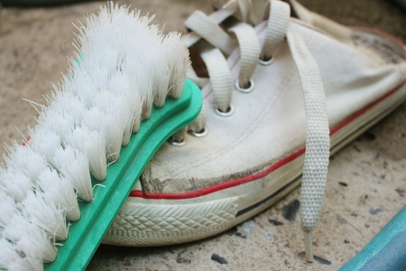 Sneakers are wash on a cement floor. Stock Photo - 60611498