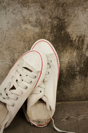 White shoes on background of cement. Stock Photo