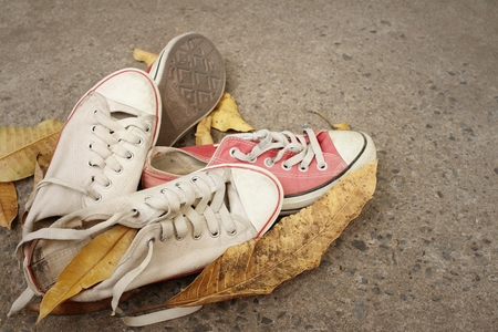 Red and white shoes on background of cement. Stock Photo - 60611135