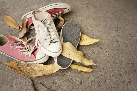 Red and white shoes on background of cement. Stock Photo - 60611141