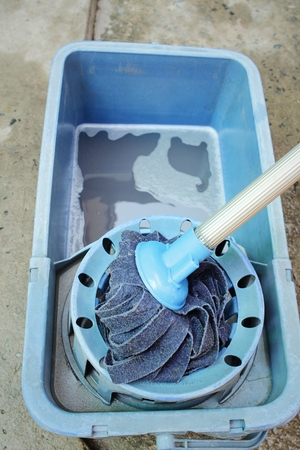 Blue bucket with cleaning mop for cleaning