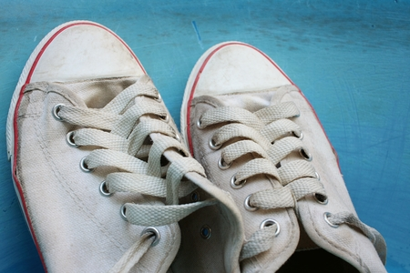 Sneakers wash enameled bowl with soapy water. Stock Photo - 60630867