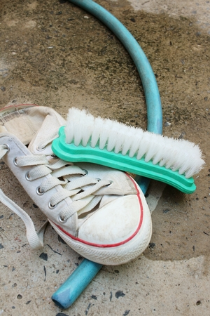 Sneakers are wash on a cement floor. Stock Photo - 60630871