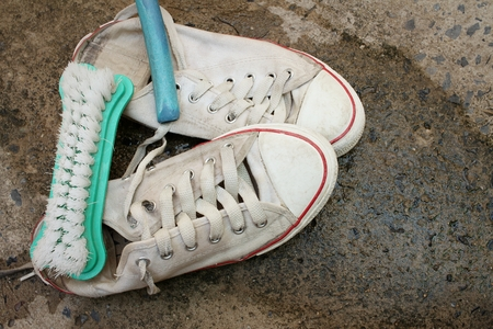 Sneakers are wash on a cement floor. Stock Photo - 60630910