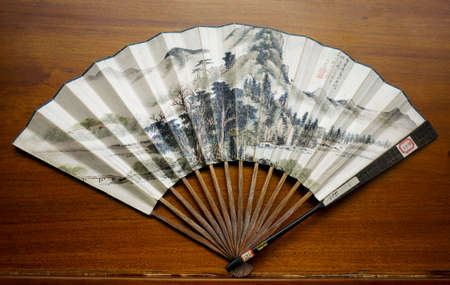 paper fan: Ancient foldable paper fan  Editorial
