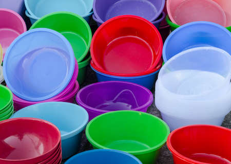Colorful plastic bowls on the open market