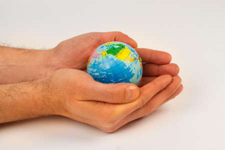 pollutants: Man holding an earth globe in his hands