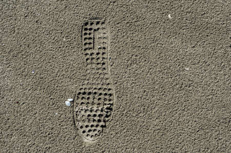 Shoe print on the sand Stock Photo