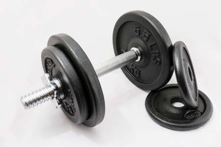 sports bar: Fitness exercise equipment dumbbell weights on white background.