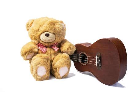 teddy bear with ukulele on white background photo