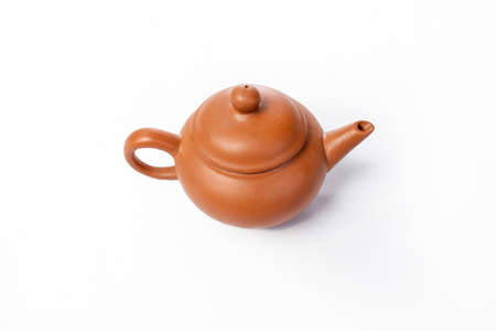 Chinese teapot for tea on a white background photo