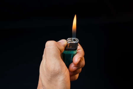 igniting: Hand with lighter igniting