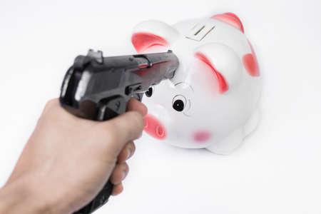 Man pointing a gun at a piggy bank no white background photo