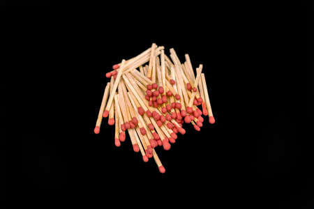 consumable: matchsticks stack up on black background