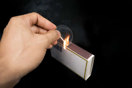 friction: Striking a match against a match box. Stock Photo