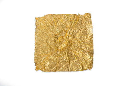 crumpled gold leaf isolated on a white background photo