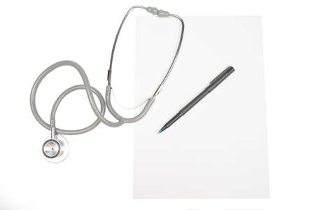 White paper, stethoscope and a pen photo