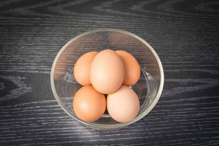 Group of brown eggs on wooden background photo
