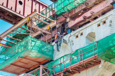 bridge construction: Workers climbs reinforcing Bridge widening construction Stock Photo