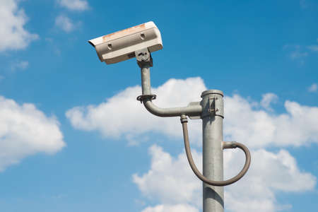 CCTV Security camera in sky background Stock Photo