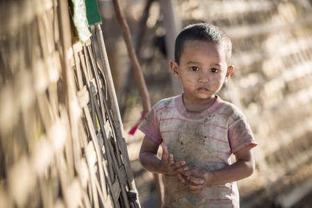 riots: Mrauk U, MYANMAR - DEC 15, 2014: Unidentified Burmese boy in Mrauk U on December 15, 2014 in Mrauk U, Myanmar.