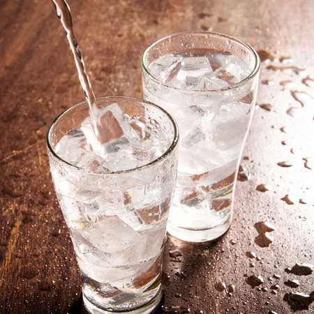 pour water: Drinking water is poured into a glass.