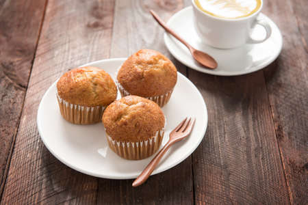 banana bread: muffin and coffee on wooden table. Stock Photo